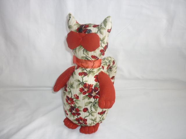 Chat rouge a fleur